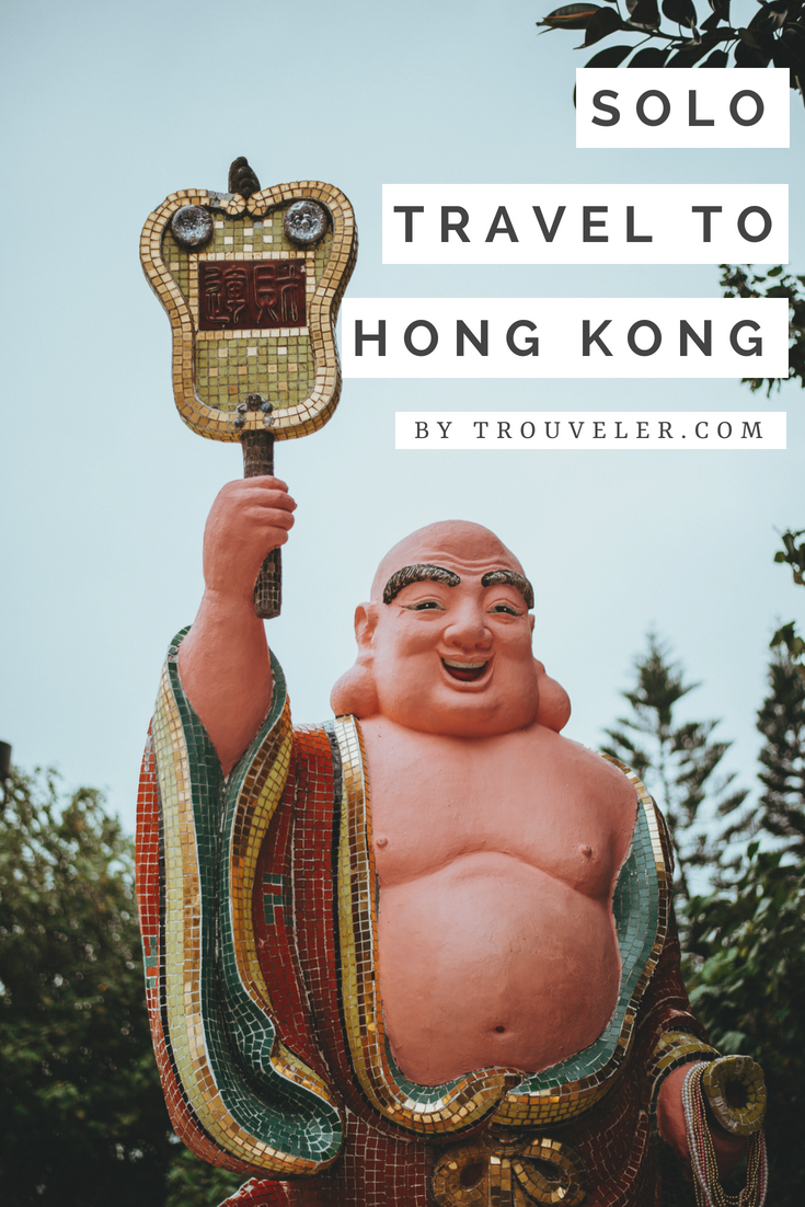 Solo travel to Hong Kong by Trouvler.com - Pinterest photo with guitar Buddha