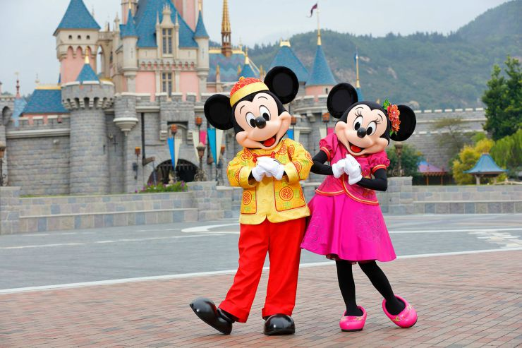 Hong Kong Disneyland Mickey and Minnie Mouse in front of the old Cinderellas Castle