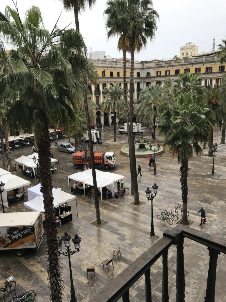 Photograph of Plaça Reial in Barcelona in the rain