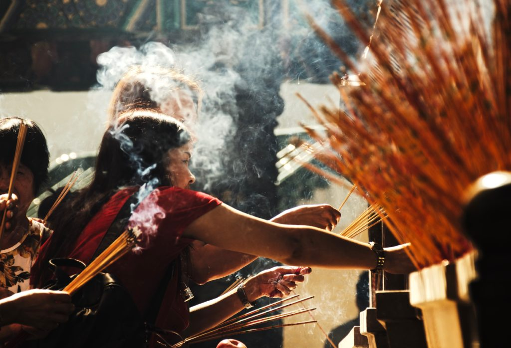 Burning incense in Hong Kong temples is believed by locals to grant wishes