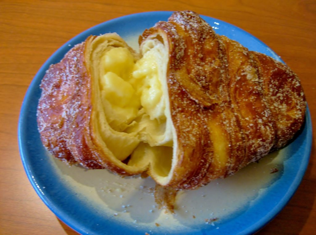 Xuixo are a delicious Barcelona dessert made with catalan crema in a deep fried pastry