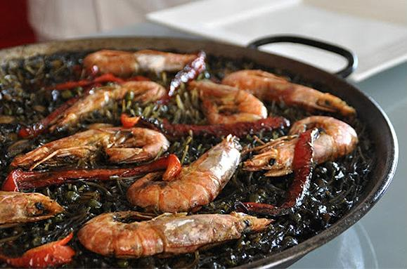 Fideua negra is similar to paella but using noodles instead of rice and squid ink for the black color and flavor