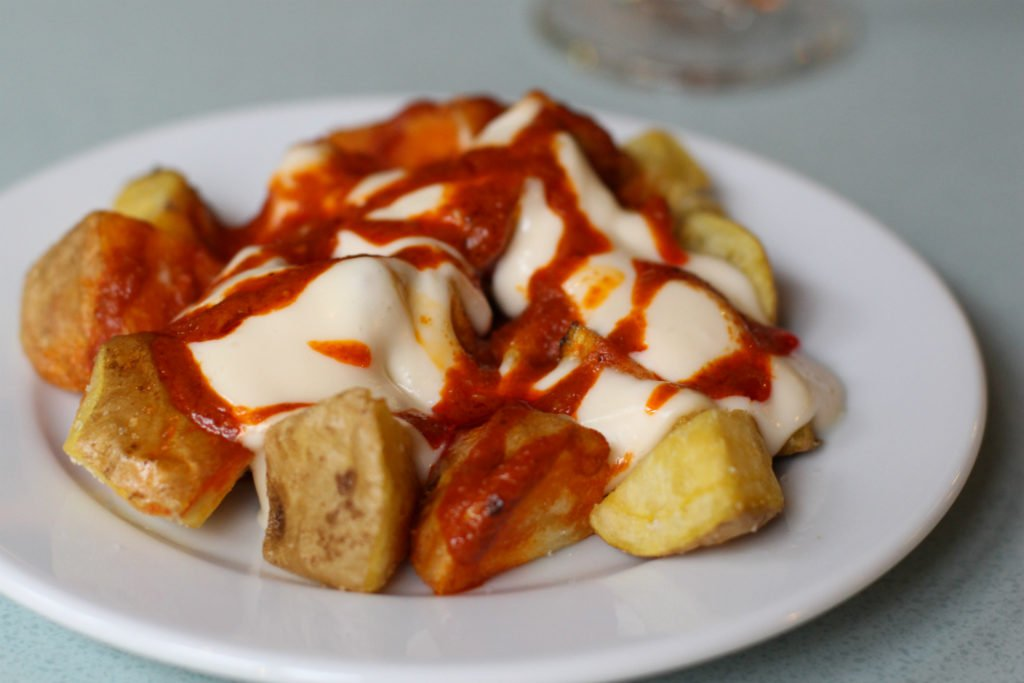 Patatas Bravas with aioli and spicy sauce in Barcelona