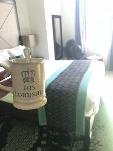Mug and bed at the Hotel Indigo Kensington London