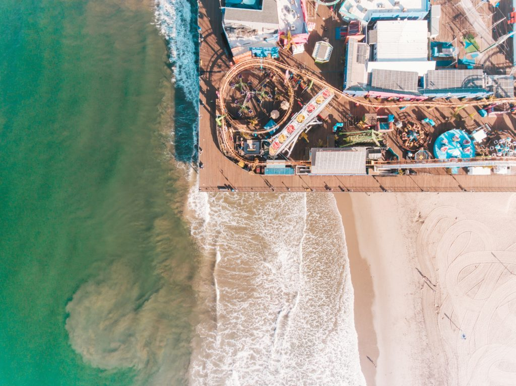 Aerial View of Santa Monica Pier and beach with waves crashing