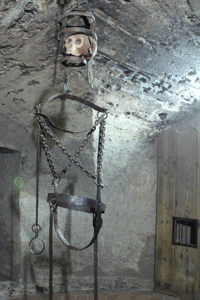 Prague Castle - Golden Lane torture device in dungeon